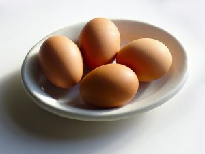 The first thing to make omelette is to whisk the eggs lightly in a bowl.
